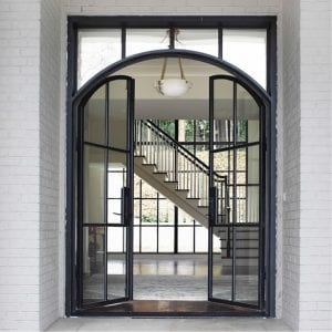 the french steel company french steel front doors open to the foyer of a home