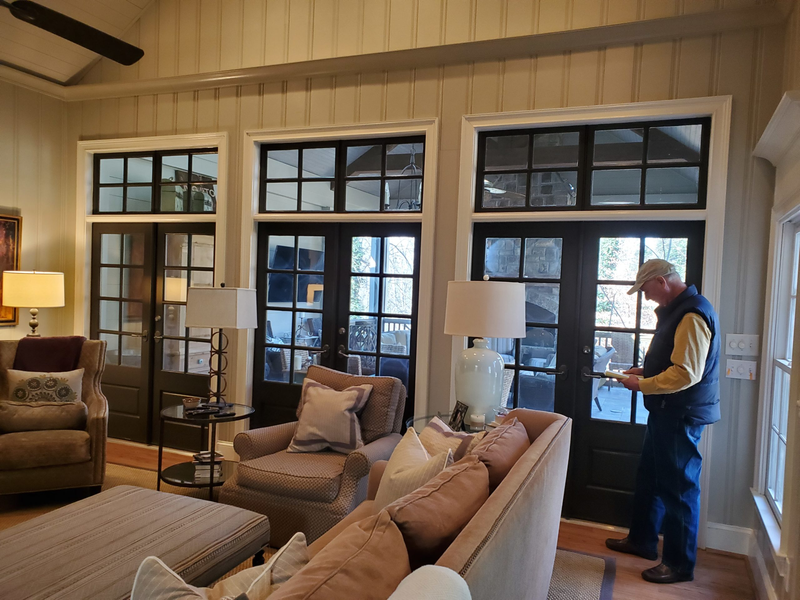 the french steel company installing six steel doors from family room to patio