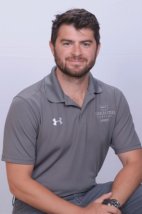 Thomas Scardino from The French Steel Company smiling with grey company polo on